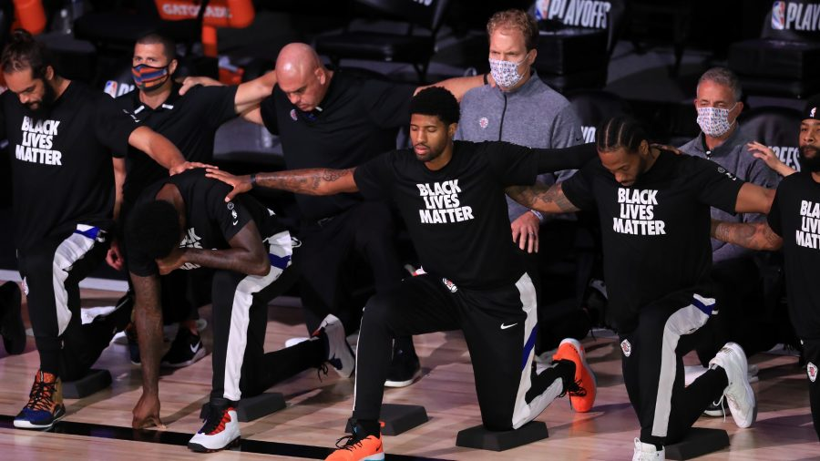 NBA Players Kneel During National Anthem on Anniversary of September 11 Attacks