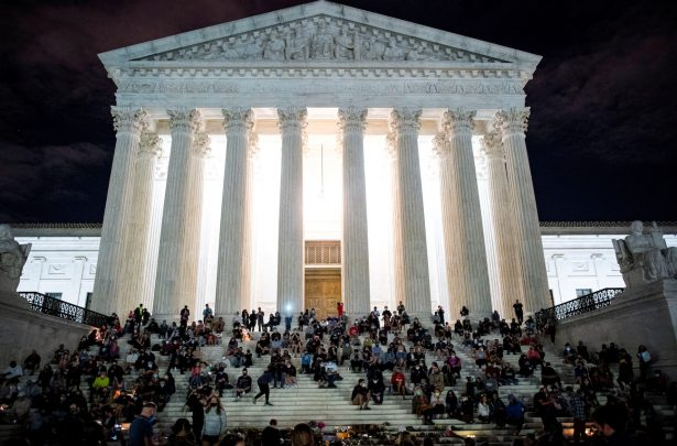 People gather in front of the U.S. Supreme Court following the death of U.S. Supreme Court Justice Ruth Bader Ginsburg, in Washington
