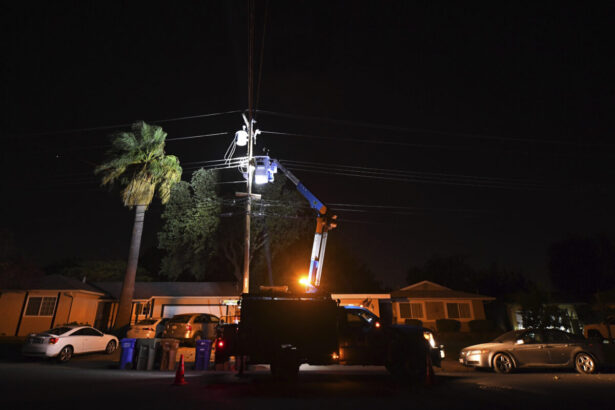 A PG&E lineman works on repairing electrical wires