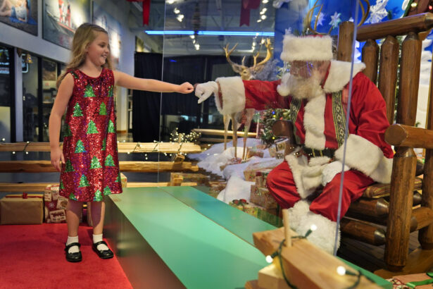 gives Santa a fist bump