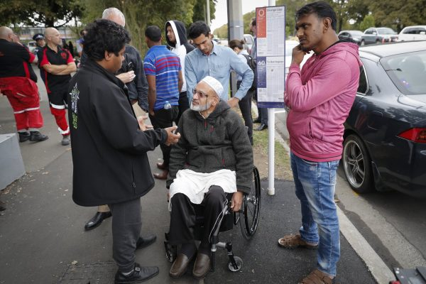 Farid Ahmed, center, a 59-year-old survivor of the Friday mosque attacks