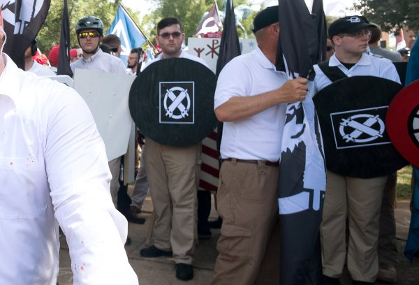 """James Alex Fields Jr., (2nd L with shield) is seen attending the """"Unite the Right"""" rally"""