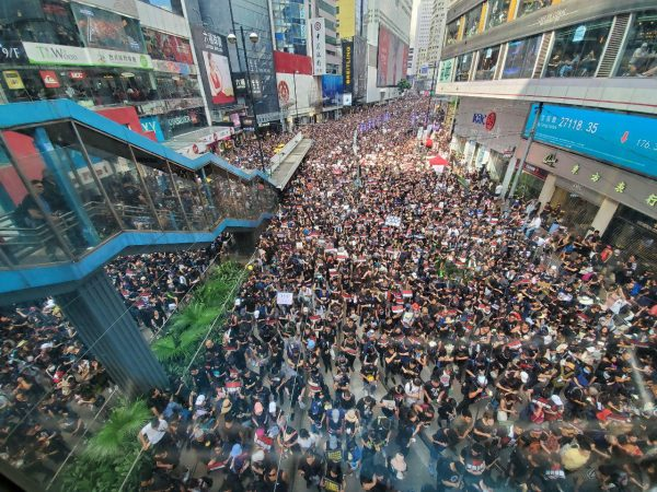 Protesters pass Causeway Bay HK