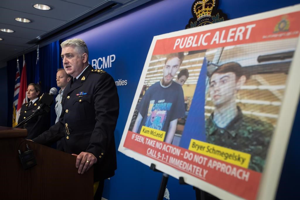 Security camera images recorded in Saskatchewan of Kam McLeod, 19, and Bryer Schmegelsky, 18, are displayed as RCMP Assistant Commissioner Kevin Hackett speaks during a news conference in Surrey, B.C., on July 23, 2019. (Darryl Dyck/The Canadian Press)