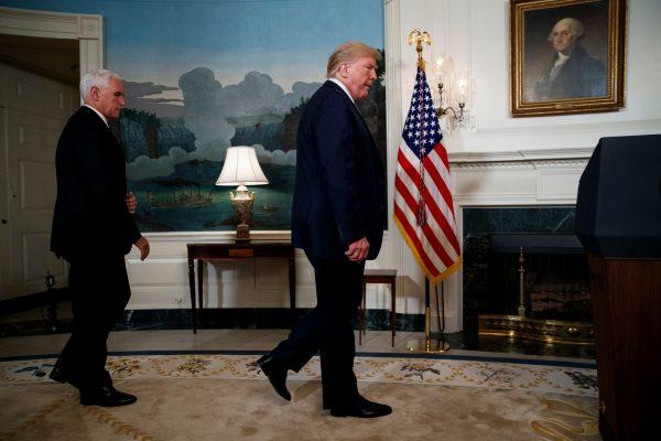 Vice President Mike Pence follows President Donald Trump