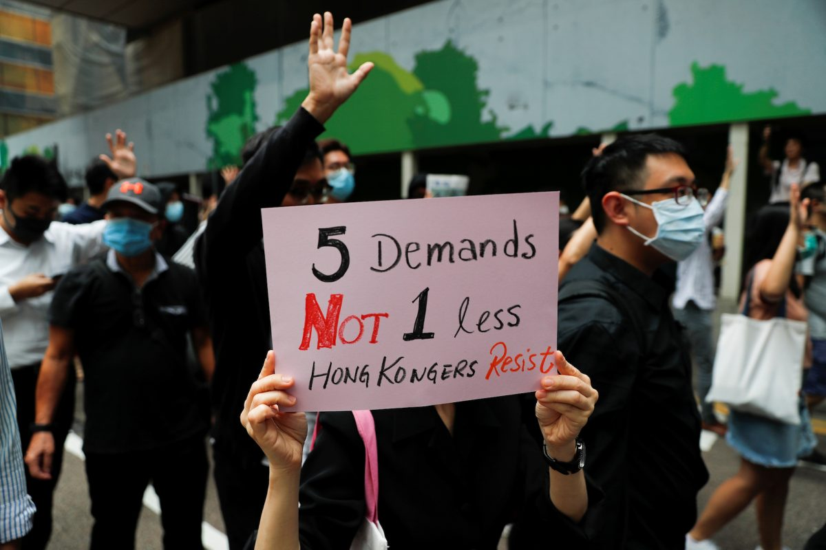 A demonstrator holds a sign while marching