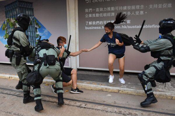 Hong Kong police chase down a couple