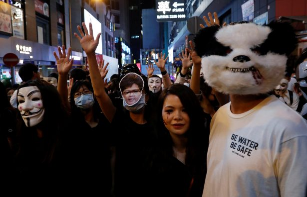 Anti-government protesters wearing costumes