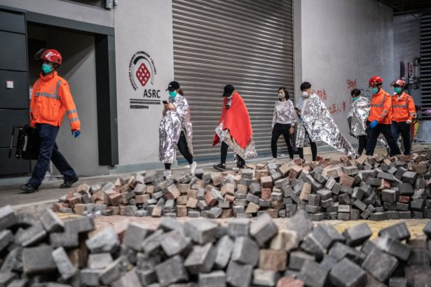 Medics lead away protesters