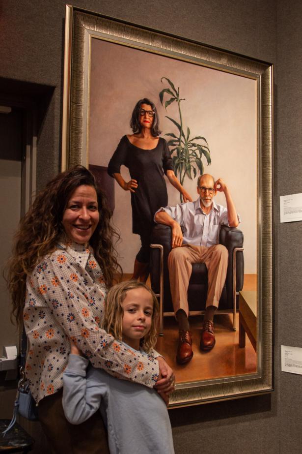 Family members of Ken Goshen with his work