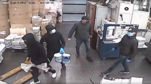 Four masked men enter the Hong Kong Epoch Times print shop
