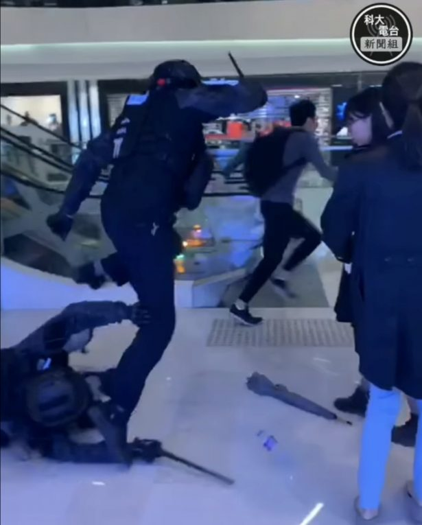 A man tries to evade police at Yuen Long mall