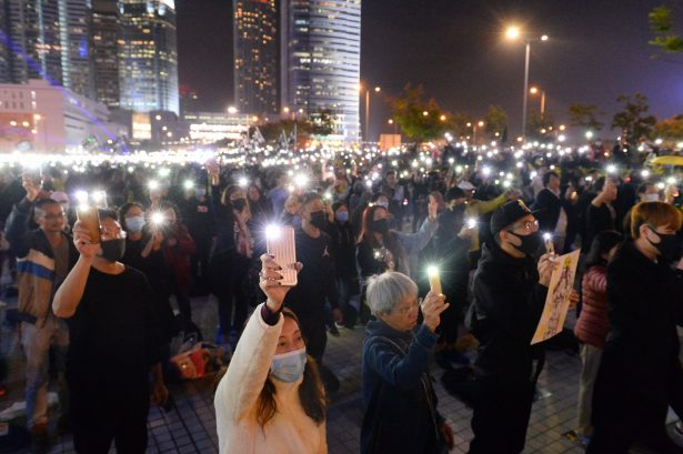 Protesters hold up their cellphone lights