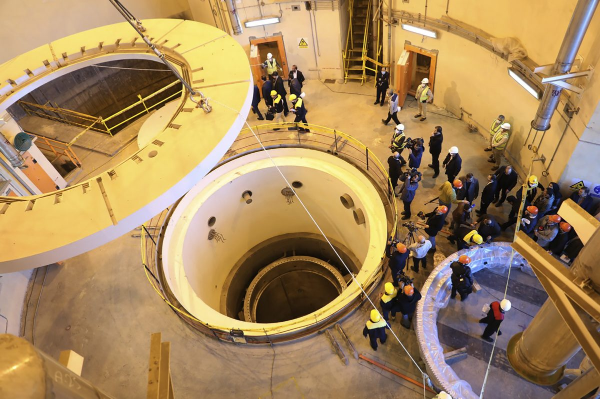 In this photo released by the Atomic Energy Organization of Iran, technicians work at the Arak heavy water reactor