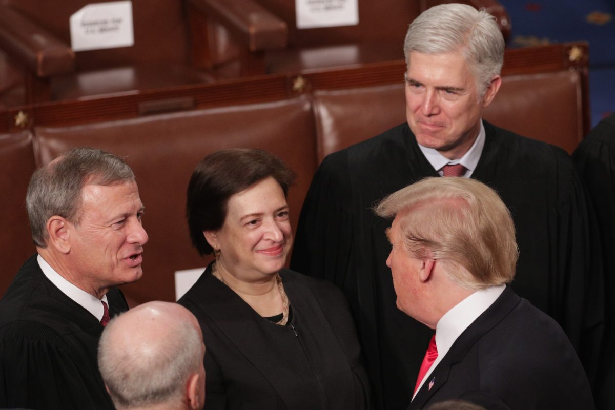 Trump greets Supreme Court Justices John Roberts