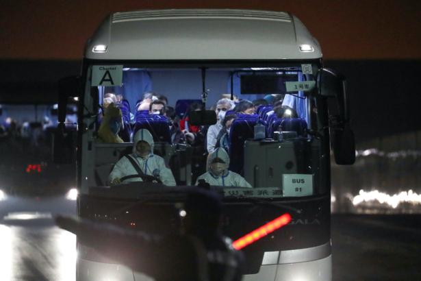 Buses believed to carry the U.S. passengers of the cruise ship Diamond Princess, where dozens of passengers were tested positive for coronavirus, leave the Daikoku Pier Cruise Terminal in Yokohama