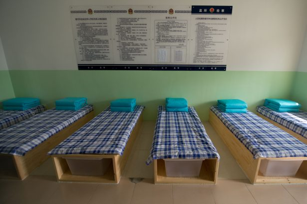 beds at an 'Interim Room' inside Chinese prison