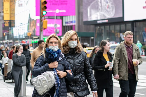 People wear masks near Times Square