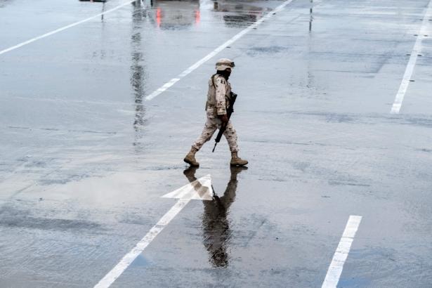 A Mexican soldier walks between lines