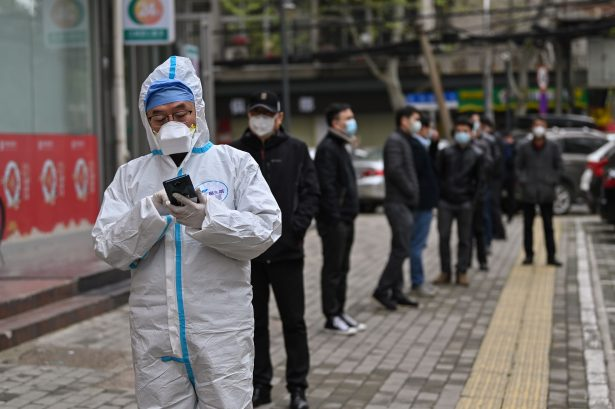 People wait to be tested for the CCP virus