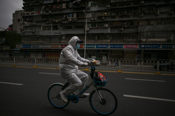 A man wearing a protective suit