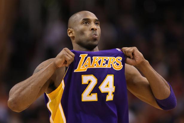 Kobe Bryant adjusts his jersey