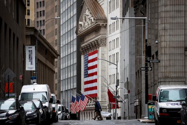 A man crosses a nearly deserted Nassau Street