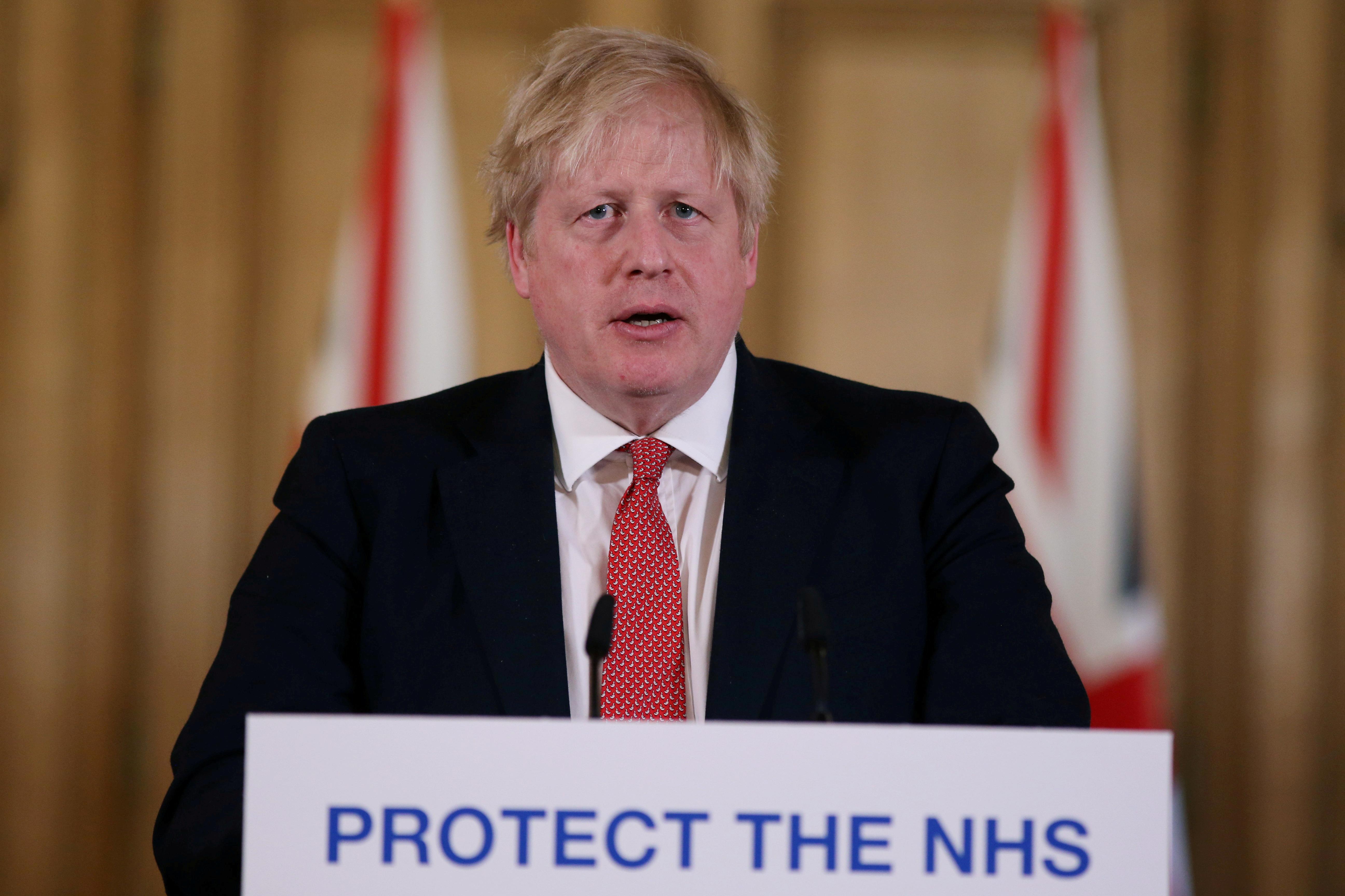 British PM Johnson gives daily address to nation on coronavirus in London