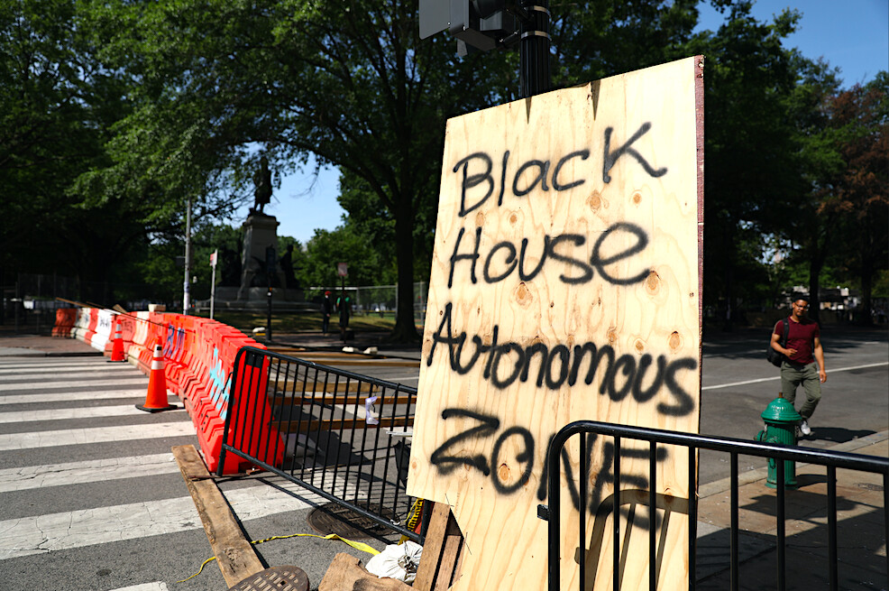 Barriers and a sign block H Street