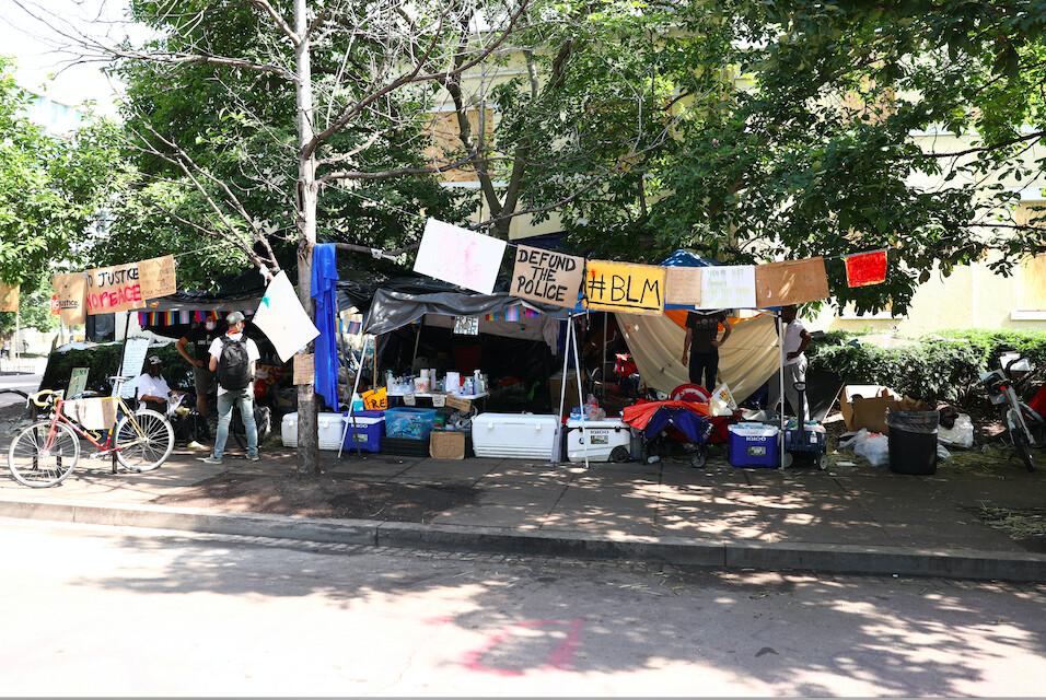 Tents line the sidewalk