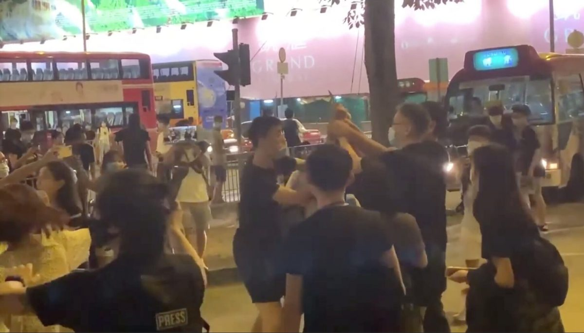 Bystanders try to subdue the knife-wielding assailant