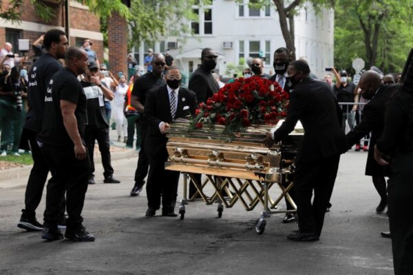 People carry George Floyd's coffin after a memorial service
