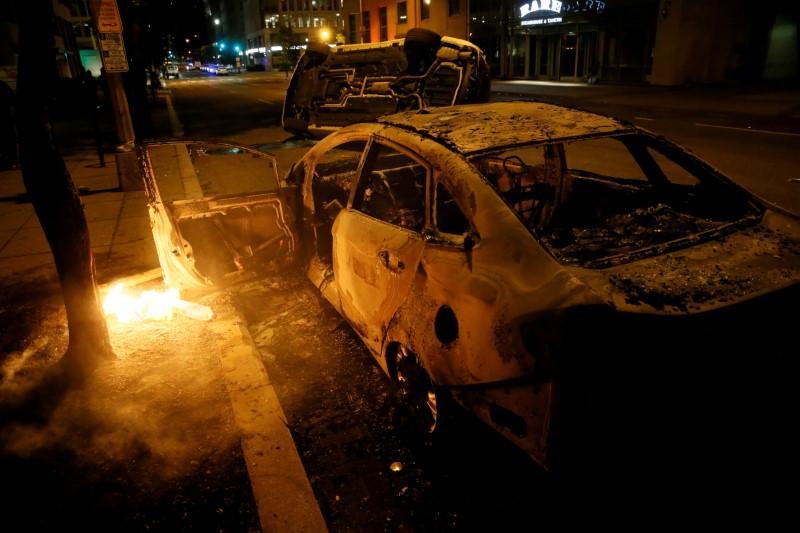 Destroyed vehicles are seen amid nationwide unrest