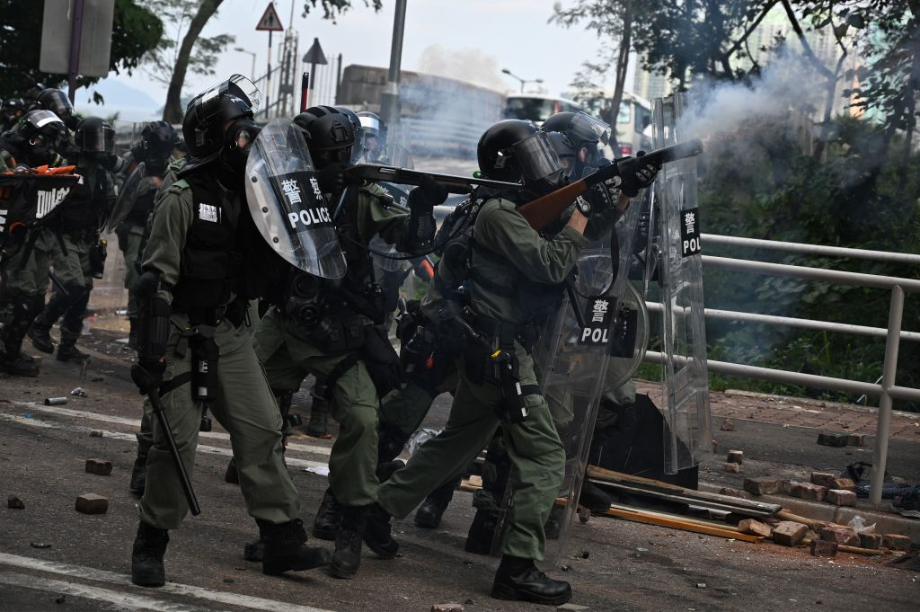 Police fire tear gas towards protesters