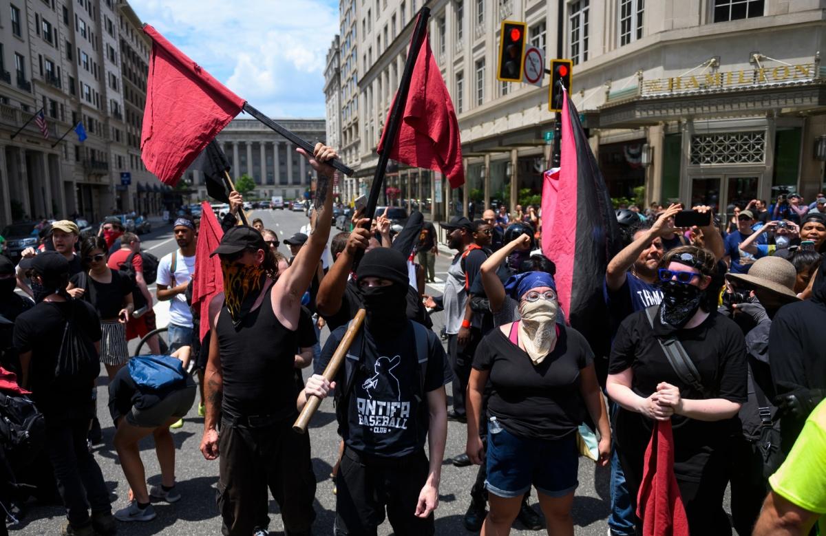 Members of Antifa group march