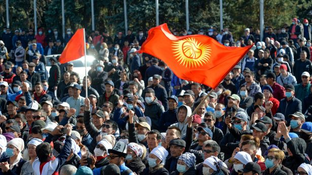 Protesters waving Kyrgyz national flags